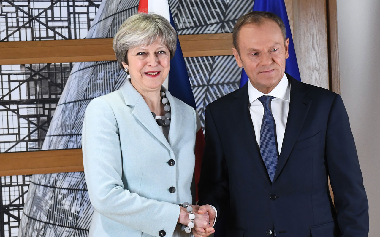 Britain and EU reach deal on Brexit divorce terms