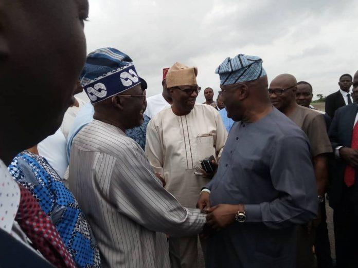 PHOTOS: Tinubu meets Atiku, Team AA at Akure Airport