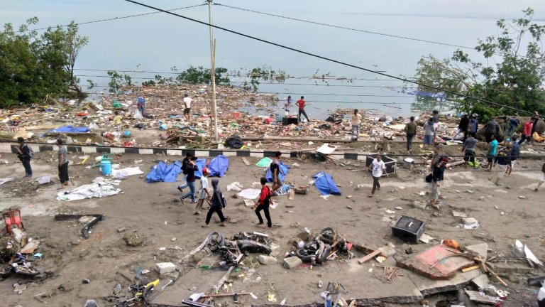 Photographs from Palu -- home to around 350,000 -- showed partially covered bodies on the ground near the shore