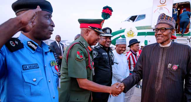 President Buhari returns from France