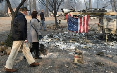 Trump visits fire-wracked California as over 1,000 declare missing