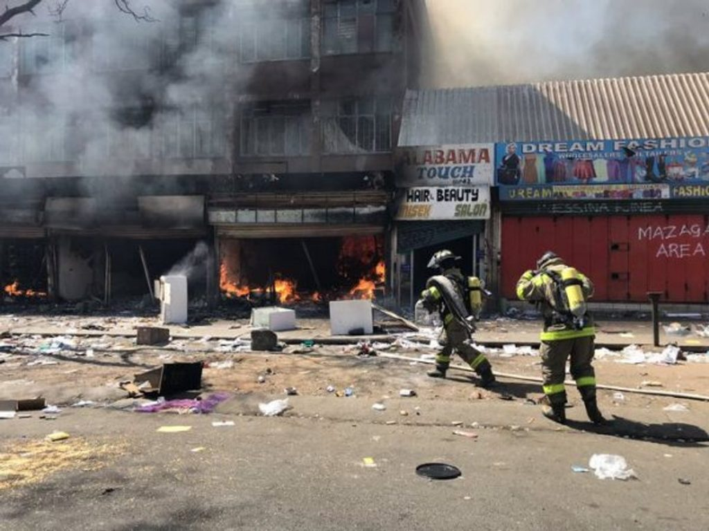 Three killed as South Africans attack, loot, burn foreigners' properties
