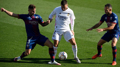 Hazard stunner gives revived Real Madrid win over Huesca - AFP-newsheadline247.com